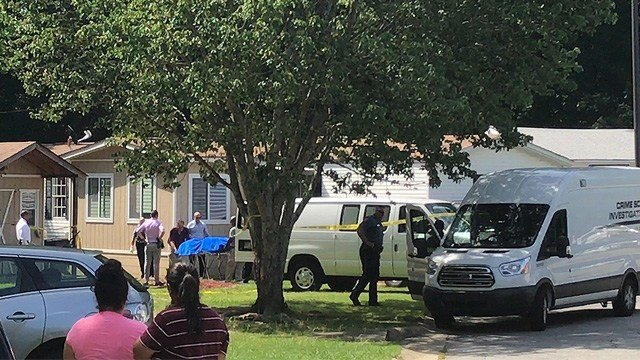 Police found four young children and their father apparently stabbed to death in a home outside Atlanta and took the mother into custody early Thursday. (AP Photo/Jonathan Landrum)
