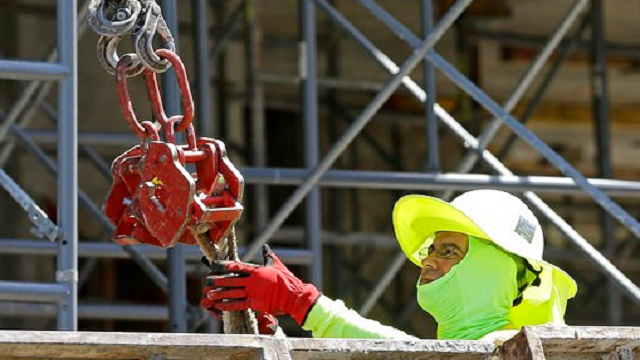 (AP Photo/Alan Diaz). In this Thursday, June 15, 2017, photo, a construction worker continues work on a condominium project in Coral Gables, Fla. On Friday, July 7, 2017, the Labor Department will release the U.S. jobs report for June.