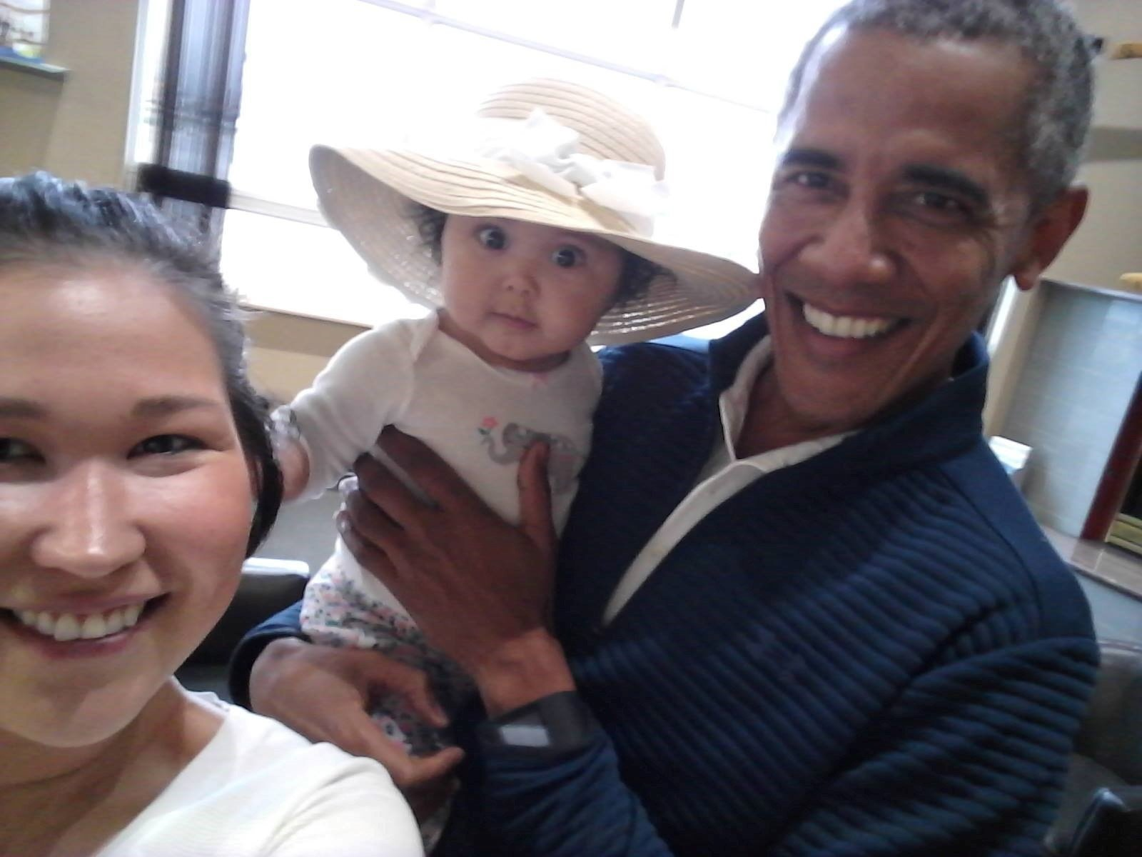 Former President Obama posed for photos with the baby during an encounter at Anchorage International Airport. (Jolene Jackinsky via CNN)