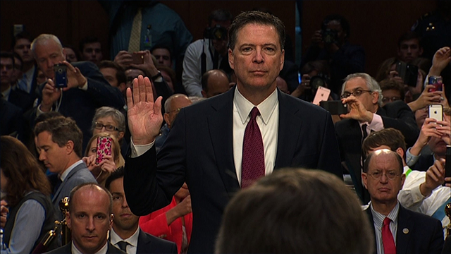 (Source: CNN) James Comey takes the oath before delivering his congressional testimony on Thursday, June 8, 2017.