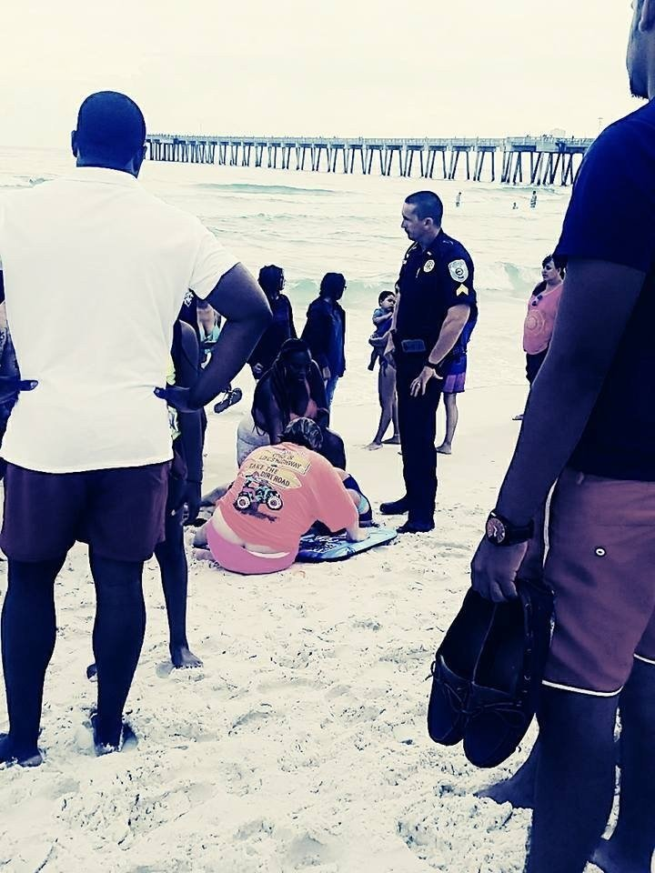 Nine beachgoers, including two children and an elderly woman, were trapped in the current at Panama City Beach in Florida on Saturday. Bystanders on the shore saw them yelling and waving their arms, and they jumped into action. (Facebook via CNN)
