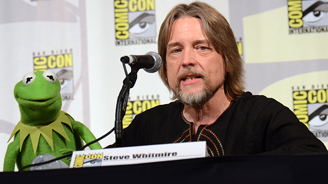 "Kermit the Frog, left, and puppeteer Steve Whitmire attend ""The Muppets"" panel on day 3 of Comic-Con International on Saturday, July 11, 2015, in San Diego. (Photo by Tonya Wise/Invision/AP)"