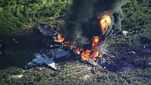 (WLBT-TV via AP). In this Monday, July 10, 2017 frame from video, smoke and flames rise from a military plane that crashed in a farm field, in Itta Bena, Miss., killing several.