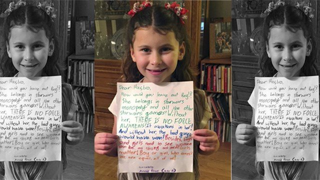 In this January 2016 photo provided by Carrie Goldman, her daughter, Annie Rose, holds a letter in Evanston, Ill., that she wrote to Hasbro asking why the female character Rey was omitted from a Monopoly set. ( (Carrie Goldman via AP)
