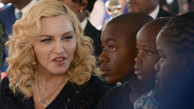 In this July 11, 2017 file photo, Madonna, left, sits with her adopted children David, Stella and Mercy, at the opening of The Mercy James Institute for Pediatric Surgery and Intensive Care. (AP Photo Thoko Chikondi)