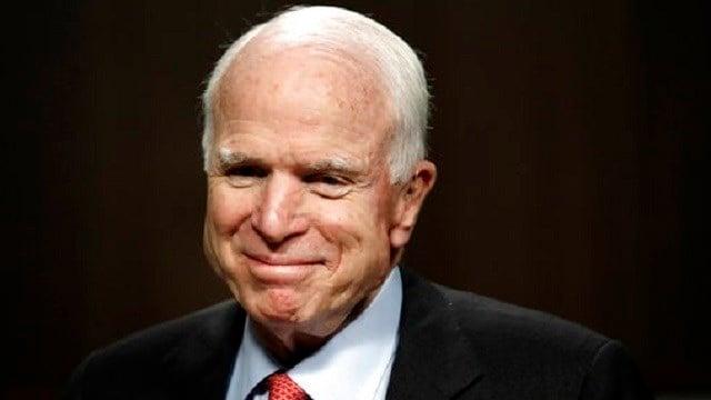AP Photo/Jacquelyn Martin, File). In this July 11, 2017, file photo, Sen. John McCain, R-Ariz., arrives on Capitol Hill in Washington.