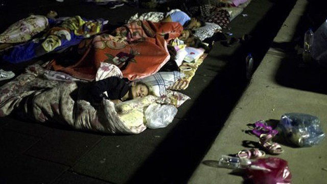 (AP Photo/Petros Giannakouris). People sleep at a playground early Saturday, July 22, 2017 following an earthquake in the Mediterranean island of Kos, Greece.