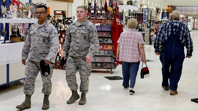 In this May 24, 2017, photo, members of the military and civilians with shopping privileges walk among stores at the Exchange, at Offutt Air Force Base, Neb. (AP Photo/Nati Harnik)