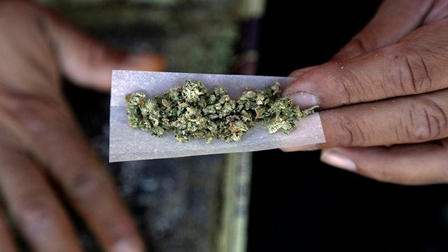 In this Wednesday, Nov. 9, 2016 file photo, a marijuana joint is rolled in San Francisco. (AP Photo/Marcio Jose Sanchez, File)