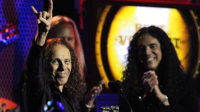 (AP Photo/Chris Pizzello, File). FILE - In this April 8, 2010, file photo, Ronnie James Dio, left, celebrates after receiving the Best Vocalist award at the second annual Revolver Golden Gods Awards in Los Angeles.