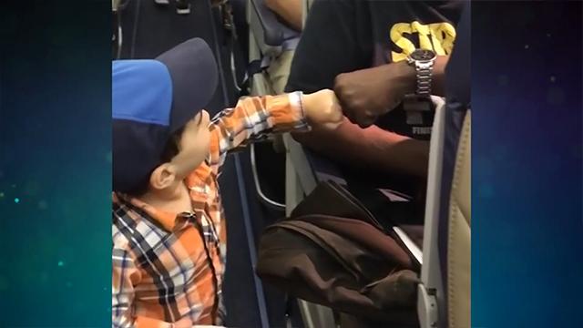 This Tiny Dude Fist Bumped Everyone On His Flight, Spreading Joy