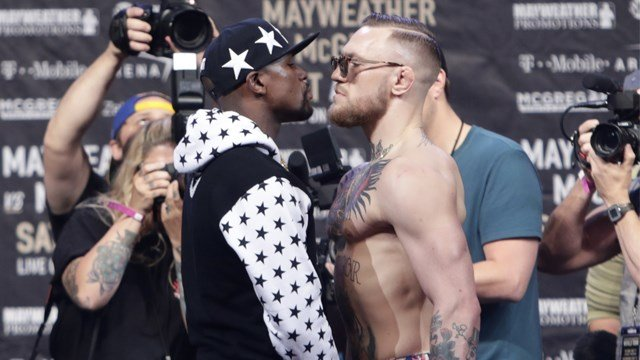 Floyd Mayweather Jr., left, and Conor McGregor, of Ireland, pause for photos during a news conference at Barclays Center Thursday, July 13, 2017, in New York. (AP Photo/Frank Franklin II)