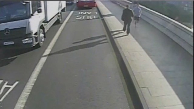 (Photo: CNN). British police searching for a jogger who knocked a woman into the path of a bus say they have arrested a man.