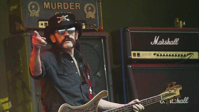 (Photo by Joel Ryan/Invision/AP, File). FILE - This June 26, 2015 file photo shows Motorhead bassist Lemmy Kilmister performing on the Pyramid stage during Glastonbury Music Festival at Worthy Farm, Glastonbury, England.