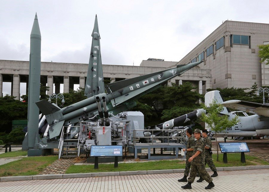 South Korean army soldiers walk by a mock Scud-B missile of North Korea, left, and other South Korean missiles on display at Korea War Memorial Museum in Seoul, South Korea. (AP Photo/Ahn Young-Join)