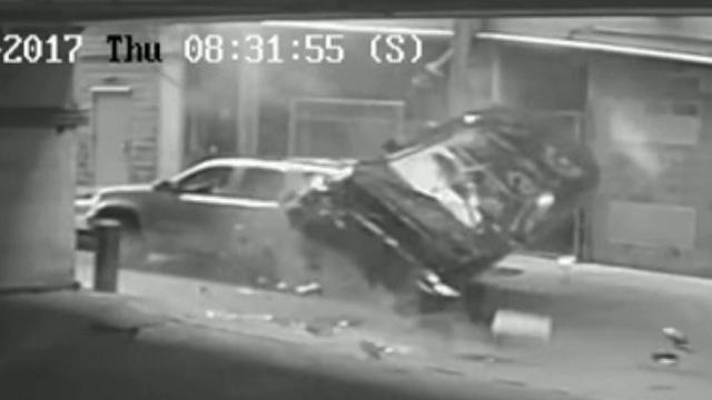 BMW plunges 7 floors in Texas parking garage