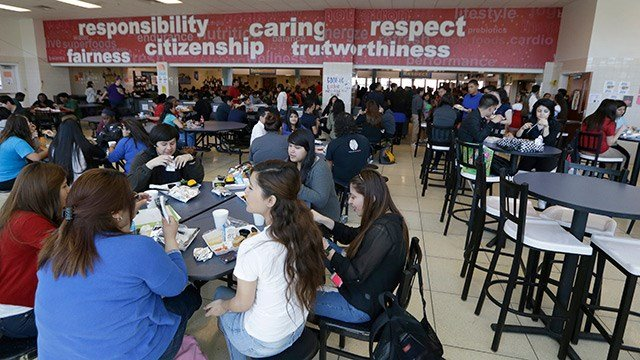 Students eat their lunch in the cafeteria at Thomas Jefferson High School in Dallas. (AP Photo/LM Otero)