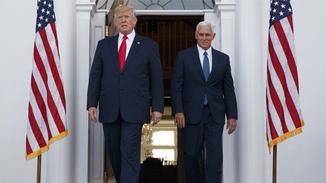 President Donald Trump, accompanied by Vice President Mike Pence, arrives to speak with reporters before a security briefing at Trump National Golf Club in Bedminster, N.J., Thursday, Aug. 10, 2017, (AP Photo/Evan Vucci)