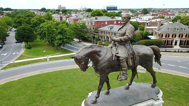 This Tuesday June 27, 2017, photo shows the statue of Confederate Gen. Robert E. Lee that stands in the middle of a traffic circle on Monument Avenue in Richmond, Va. (AP Photo/Steve Helber)