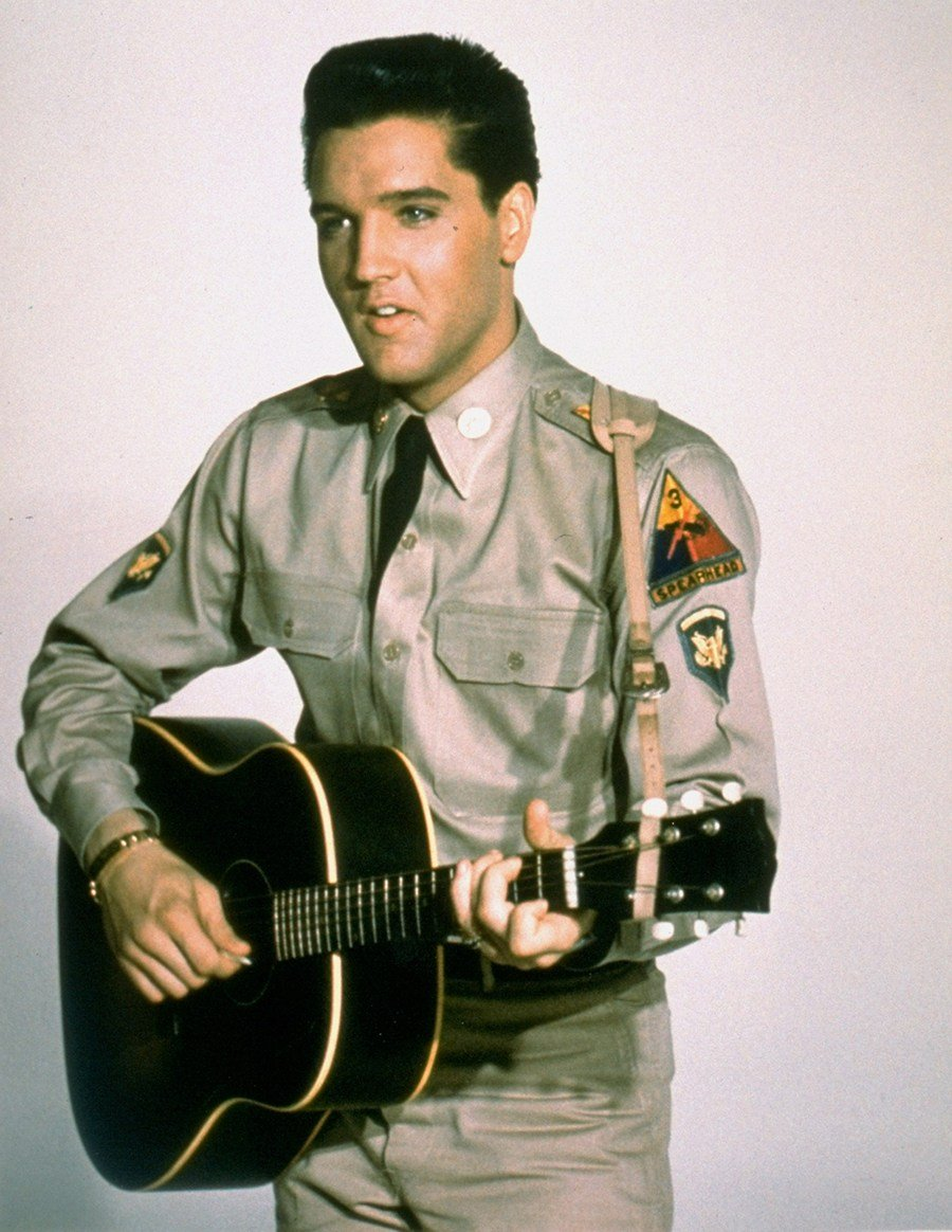 "This is a publicity photo from the 1960 film ""G.I. Blues"", starring Elvis Presley as a guitar playing tank gunner with the American Army in West Germany. (AP Photo)"