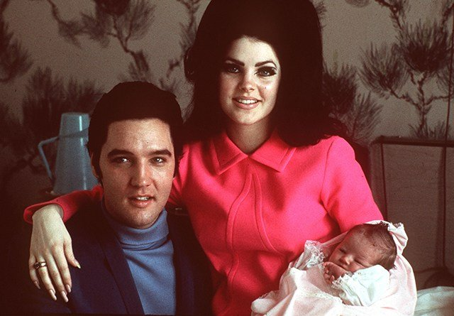 Elvis Presley poses with wife Priscilla and daughter Lisa Marie, in a room at Baptist hospital in Memphis, Tenn., February 05, 1968. (AP Photo)