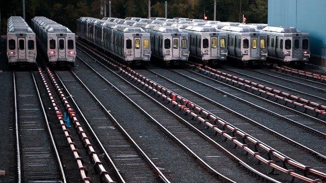 In this Tuesday, Nov. 1, 2016, file photo, Market-Frankford line trains remain idle at a Southeastern Pennsylvania Transportation Authority (SEPTA) station in Upper Darby, Pa. (AP Photo/Jacqueline Larma, File)