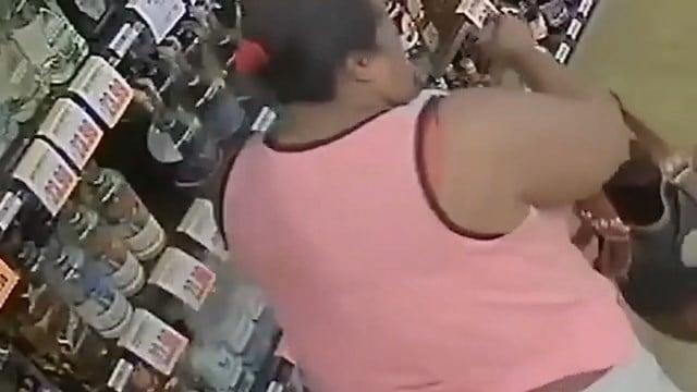 Woman hides, steals bottles of liquor
