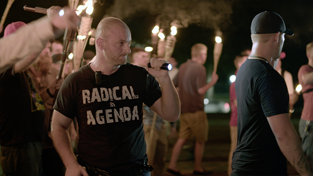 (Vice News Tonight via AP)  In this Friday, Aug. 11, 2017, image made from a video provided by Vice News Tonight, Christopher Cantwell attends a white nationalist rally in Charlottesville, Va.
