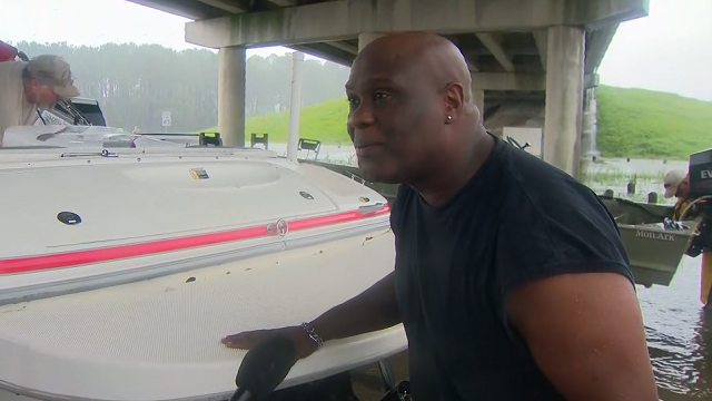 """A volunteer rescuer in Dickinson, Texas, launches a boat on a mission to """"save some lives."""" (Source: CNN)"""