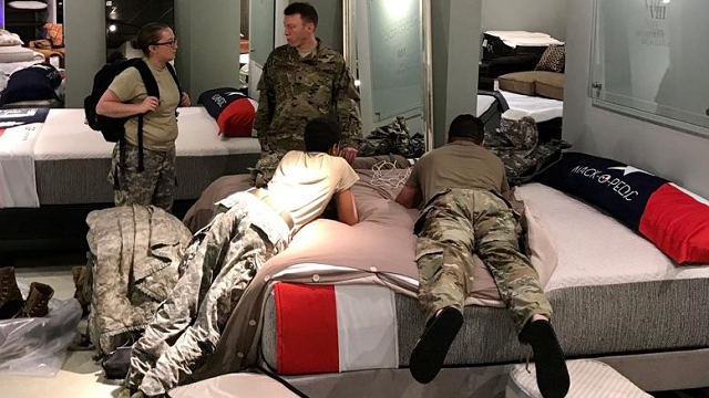 National Guard troops rested at a Gallery Furniture store in Richmond, Texas between their rescue missions during Tropical Storm Harvey. (Credit: Jim McIngvale, Gallery Furniture)