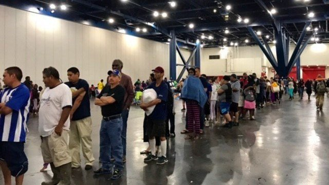 There are areas stationed all around inside the Houston Convention Center that includes a toiletries station, clothing station, food & water station, bedding station, voucher for transportation station, pharmacy area, medical and a charging station. (AP)