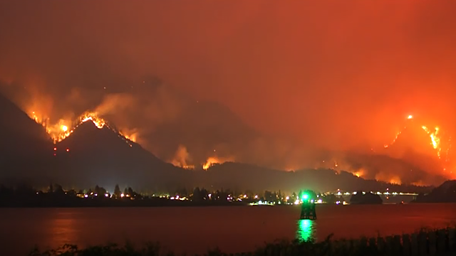 The growing Eagle Creek wildfire has caused evacuations and sparked blazes across the Columbia River in Washington state. (Source: Oca Hoeflein / AP)