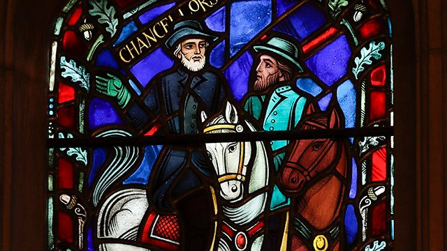 A detail of stained glass windows depicting two iconic Confederate generals that are being removed is seen at the Washington National Cathedral in Washington, Wednesday, Sept. 6, 2017. (AP Photo/Carolyn Kaster)