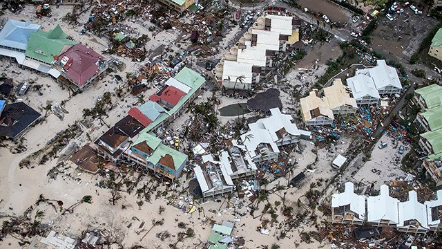 This Sept. 6, 2017 photo provided by the Dutch Defense Ministry shows storm damage in the aftermath of Hurricane Irma, in St. Maarten. Irma cut a path of devastation across the northern Caribbean.