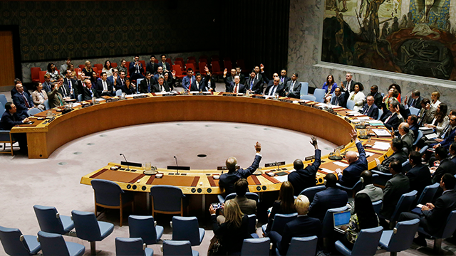 The United Nations Security Council votes to pass a new sanctions resolution against North Korea during a meeting at U.N. headquarters, Monday, Sept. 11, 2017. (AP Photo/Jason DeCrow)