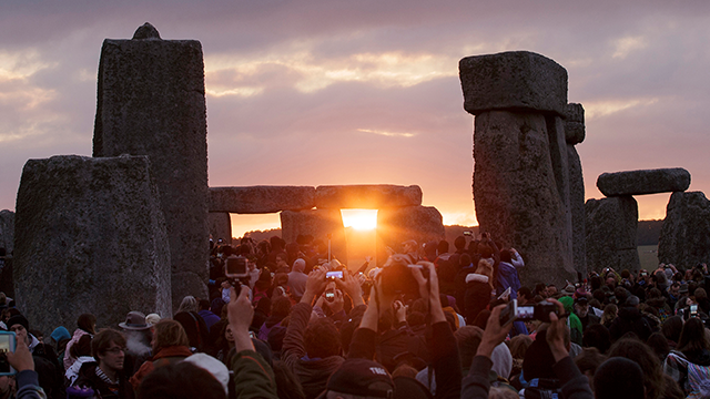 (AP Photo/Tim Ireland, File) In this June 21, 2015, file photo, the sun rises as thousands of revelers gathered at the ancient stone circle Stonehenge to celebrate the Summer Solstice, the longest day of the year, near Salisbury, England.