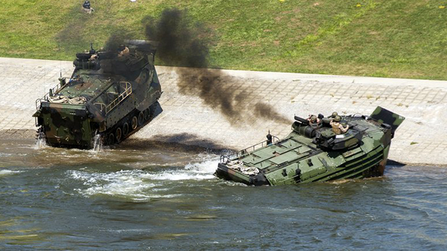 (Lance Cpl. Jered Stone/U.S. Marine Corps via AP). This Sept. 6, 2016, photo released by the U.S. Marine Corps shows Marines with the 2nd Amphibious Assault Battalion aboard AAV-7 Amphibious Assault vehicles during an exercise on the Cumberland River i...