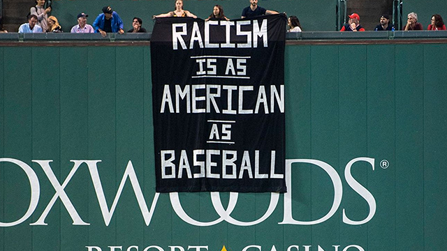 (AP Photo/Charles Krupa) A banner is unfurled over the left field wall during the fourth inning of a baseball game between the Boston Red Sox and Oakland Athletics at Fenway Park in Boston, Wednesday, Sept. 13, 2017.
