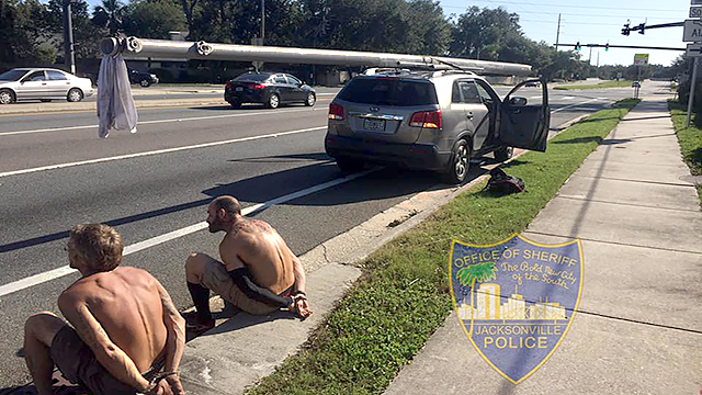 Deputies arrested two men accused of stealing a power utility pole in Jacksonville, Florida. (Source: Jacksonville Sheriff's Office)