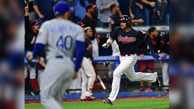 Cleveland Indians' Erik Gonzalez scores on a double by Francisco Lindor in the ninth inning of a baseball game against the Kansas City Royals, Thursday, Sept. 14, 2017, in Cleveland. (AP Photo/David Dermer)