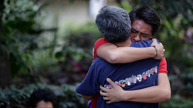 Men hug, crying with joy, as they reunite hours after an earthquake in the Condesa neighborhood of Mexico City, Tuesday, Sept. 19, 2017.  (AP Photo/Rebecca Blackwell)
