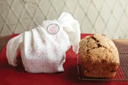 © BH&G - Coffee Banana Bread  -  Pick up a needle and thread to create a starry sensation out of a cotton dish towel. It's a warm and wonderful wrap for a little loaf.