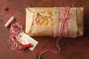 © BH&G - Chocolate Hazelnut Bread  -  Bundle your favorite quick bread recipe in brown parchment paper and band with a bit of burlap and colorful string.