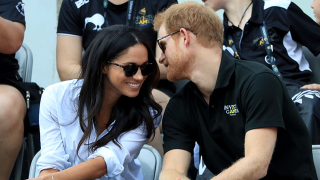 Prince Harry and his fiance, Meghan Markle, attend a wheelchair tennis event at the Invictus Games in Toronto, Monday, Sept. 25, 2017. (Nathan Denette/The Canadian Press via AP)