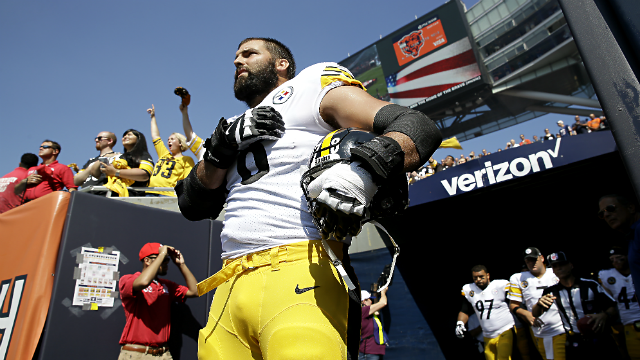 Pittsburgh Steelers offensive tackle and former Army Ranger Alejandro Villanueva (78) stands outside the tunnel alone during the national anthem before an NFL football game against the Chicago Bears, Sunday, Sept. 24, 2017. (AP Photo/Nam Y. Huh)
