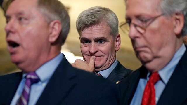 (AP Photo/Alex Brandon) Sen. Bill Cassidy, R-La., center, listens as Sen. Lindsey Graham, R-S.C., left, speaks, accompanied by Senate Majority Leader Mitch McConnell of Ky.