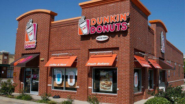 "Dunkin' is thinking about dumping ""Donuts"" from its name. A new location in Pasadena, Calif., will be called simply Dunkin', a move that parent company Dunkin' Brands Inc. calls a test. (AP Photo/Sue Ogrocki, File, 2016)"