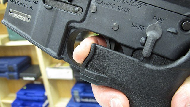 """In this Feb. 1, 2013 photo, an employee of North Raleigh Guns demonstrates how a """"bump"""" stock works."""