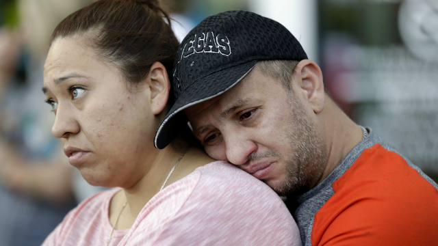 Rosa and Alan Duarte become emotional during a vigil at City Hall in Las Vegas, Monday, Oct. 2, 2017.  (AP Photo/Gregory Bull)
