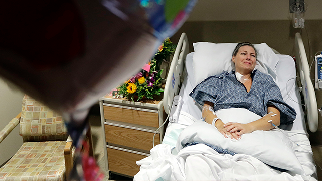 (AP Photo/Gregory Bull) Natalie Vanderstay answers questions from her hospital bed at University Medical Center on Tuesday, Oct. 3, 2017, in Las Vegas.